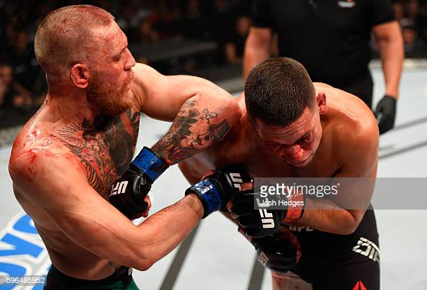 Conor McGregor of Ireland elbows Nate Diaz in their welterweight bout during the UFC 202 event at T-Mobile Arena on August 20, 2016 in Las Vegas,...