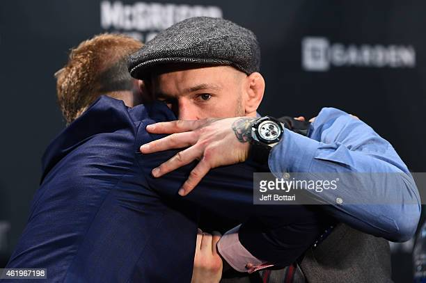 Conor McGregor of Ireland embraces Paddy Holohan of Ireland at the post fight press conference during the UFC Fight Night event at the TD Garden on...