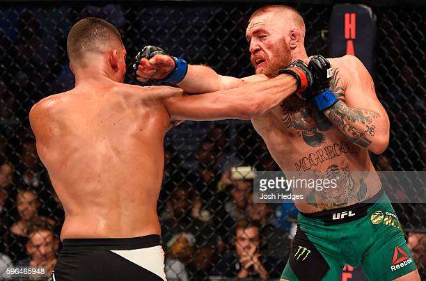 Conor McGregor of Ireland exchanges punches with Nate Diaz in their welterweight bout during the UFC 202 event at T-Mobile Arena on August 20, 2016...