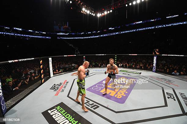 Conor McGregor of Ireland faces Dennis Siver of Germany in their featherweight fight during the UFC Fight Night event at the TD Garden on January 18...