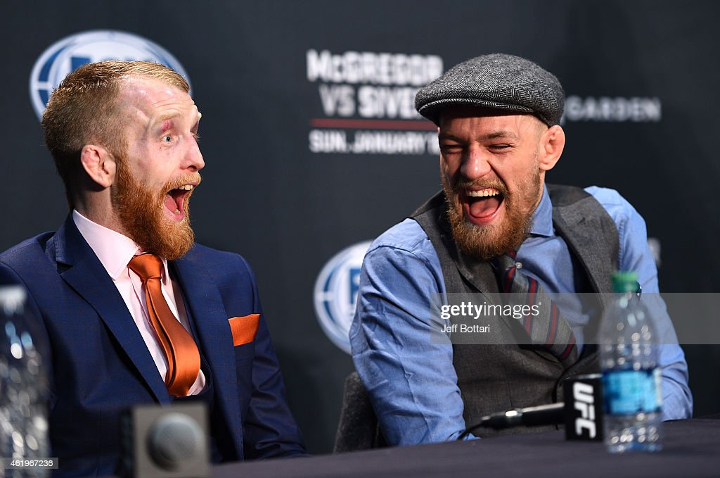 Conor McGregor of Ireland interacts with Paddy Holohan of Ireland at the post fight press conference during the UFC Fight Night event at the TD Garden on January 18, 2015 in Boston, Massachusetts.