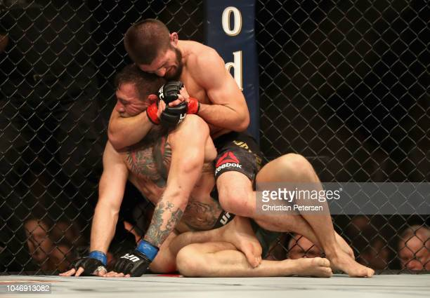 Conor McGregor of Ireland is held by Khabib Nurmagomedov of Russia before submitting in defeat in their UFC lightweight championship bout during the...