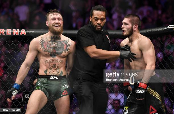 Conor McGregor of Ireland is separated from Khabib Nurmagomedov of Russia in their UFC lightweight championship bout during the UFC 229 event inside...