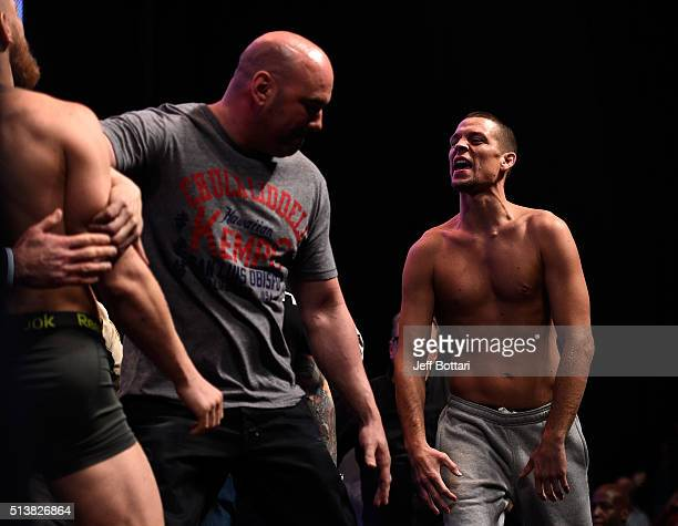 Conor McGregor of Ireland is separated from Nate Diaz by UFC President Dana White during the UFC 196 weigh-in at the MGM Grand Garden Arena on March...
