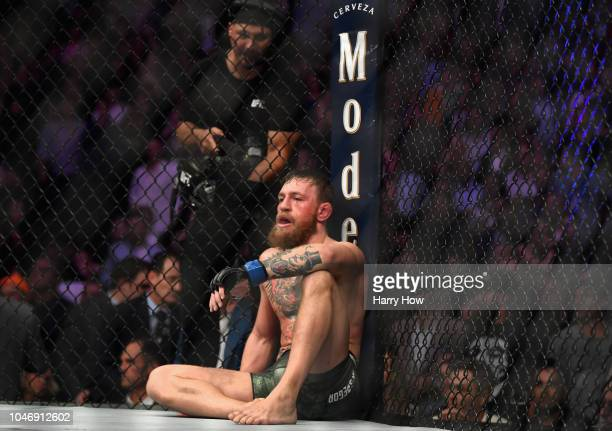 Conor McGregor of Ireland is sits on the mat in the octagon after being defeated by Khabib Nurmagomedov of Russia by submission in their UFC...