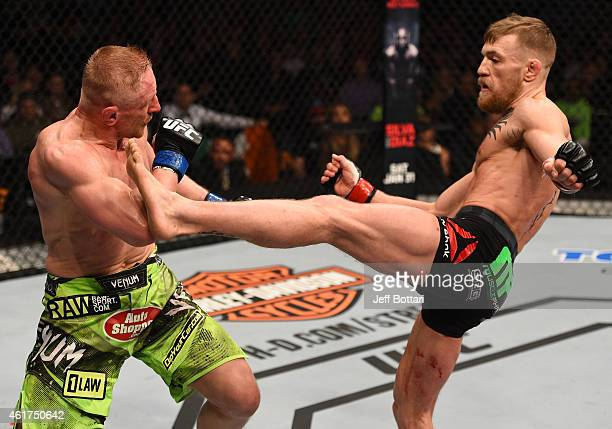 Conor McGregor of Ireland kicks Dennis Siver of Germany in their featherweight fight during the UFC Fight Night event at the TD Garden on January 18...