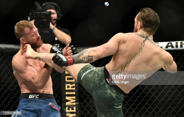 Conor McGregor of Ireland kicks Donald Cerrone in their welterweight fight during the UFC 246 event at T-Mobile Arena on January 18, 2020 in Las...