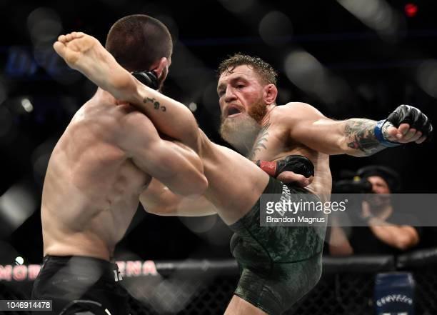 Conor McGregor of Ireland kicks Khabib Nurmagomedov of Russia in their UFC lightweight championship bout during the UFC 229 event inside TMobile...
