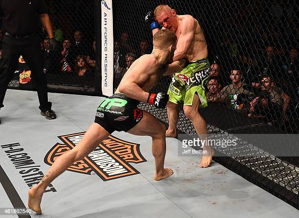 Conor McGregor of Ireland lands a punch to the torso of Dennis Siver of Germany in their featherweight fight during the UFC Fight Night event at the...
