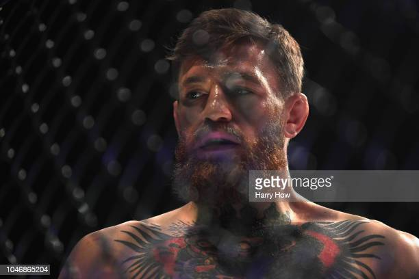 Conor McGregor of Ireland looks on in the octagon before competing against Khabib Nurmagomedov of Russia in their UFC lightweight championship bout...