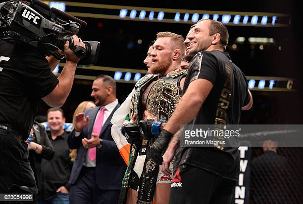Conor McGregor of Ireland poses for a picture with his team after facing Eddie Alvarez in their UFC lightweight championship fight during the UFC 205...