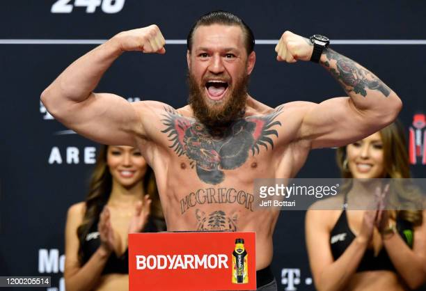 Conor McGregor of Ireland poses on the scale during the UFC 246 weigh-in at Park Theater at Park MGM on January 17, 2020 in Las Vegas, Nevada.