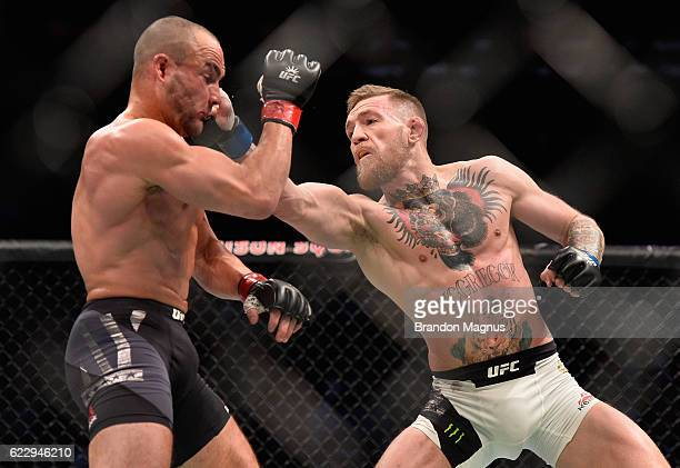 Conor McGregor of Ireland punches Eddie Alvarez in their UFC lightweight championship fight in their UFC lightweight championship fight during the...