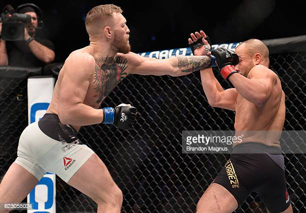 Conor McGregor of Ireland punches Eddie Alvarez in their UFC lightweight championship fight during the UFC 205 event at Madison Square Garden on...