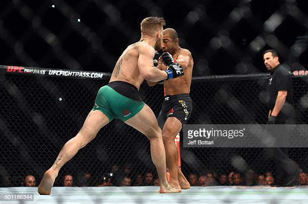 Conor McGregor of Ireland punches Jose Aldo of Brazil in their featherweight championship bout during the UFC 194 event inside MGM Grand Garden Arena...