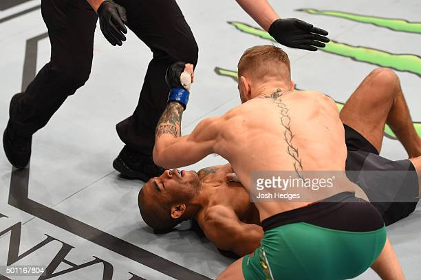 Conor McGregor of Ireland punches Jose Aldo of Brazil in their UFC featherweight championship bout during the UFC 194 event inside MGM Grand Garden...