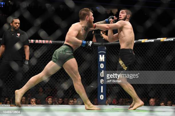 Conor McGregor of Ireland punches Khabib Nurmagomedov of Russia in their UFC lightweight championship bout during the UFC 229 event inside TMobile...