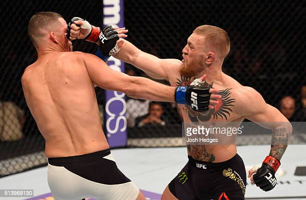 Conor McGregor of Ireland punches Nate Diaz in their welterweight bout during the UFC 196 event inside MGM Grand Garden Arena on March 5 2016 in Las...