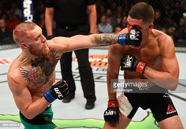 Conor McGregor of Ireland punches Nate Diaz in their welterweight bout during the UFC 202 event at T-Mobile Arena on August 20, 2016 in Las Vegas,...