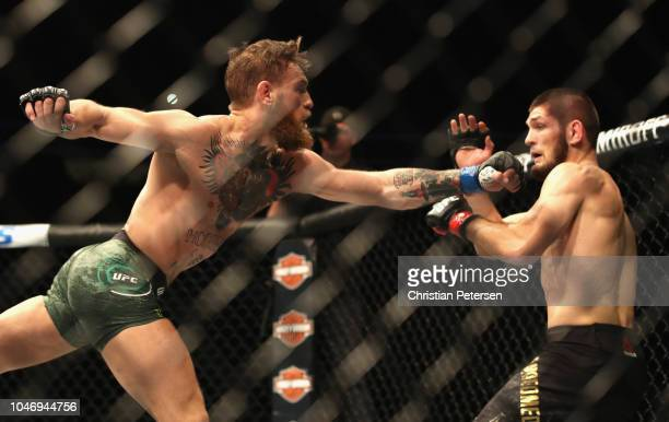 Conor McGregor of Ireland reaches for Khabib Nurmagomedov of Russia in their UFC lightweight championship bout during the UFC 229 event inside...
