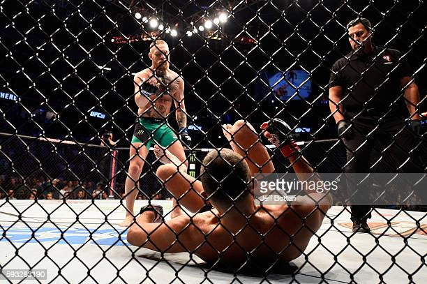 Conor McGregor of Ireland signal to Nate Diaz to stand after knocking him down in their welterweight bout during the UFC 202 event at T-Mobile Arena...