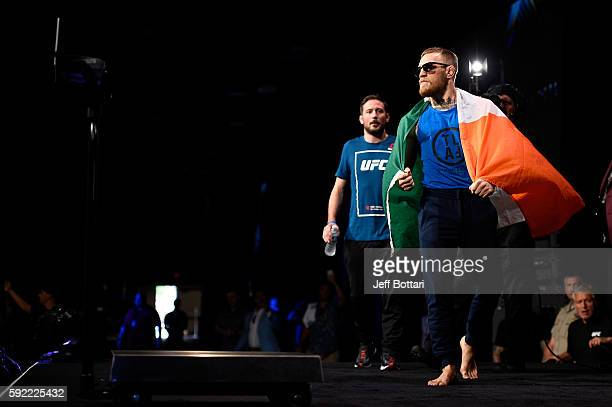 Conor McGregor of Ireland steps on stage during the UFC 202 weighin at the MGM Grand Marquee Ballroom on August 19 2016 in Las Vegas Nevada
