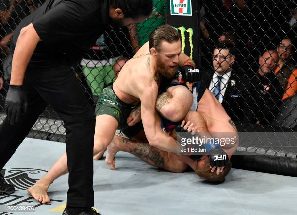 Conor McGregor of Ireland strikes Donald Cerrone in their welterweight fight during the UFC 246 event at T-Mobile Arena on January 18, 2020 in Las...