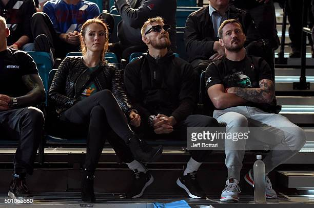 Conor McGregor of Ireland waits backstage with his girlfriend Dee and coach John Kavanaugh during the UFC 194 Weighin event at the MGM Grand Garden...