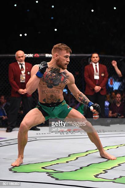 Conor McGregor of Ireland warms up in the Octagon before facing Jose Aldo of Brazil in their featherweight championship bout during the UFC 194 event...