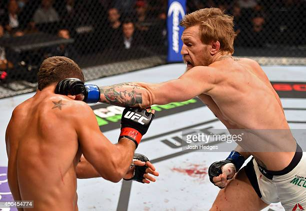 Conor McGregor pucnhes Chad Mendes in their UFC interim featherweight title fight during the UFC 189 event inside MGM Grand Garden Arena on July 11...