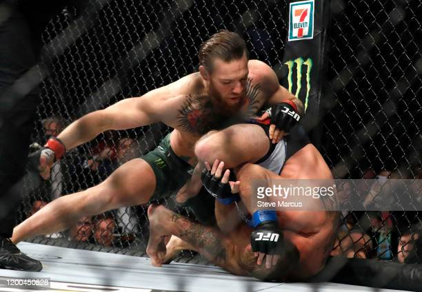 Conor McGregor punches Donald Cerrone in a welterweight bout during UFC246 at TMobile Arena on January 18 2020 in Las Vegas Nevada McGregor won by...