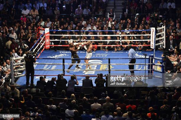Conor McGregor punches Floyd Mayweather Jr. In their super welterweight boxing match at T-Mobile Arena on August 26, 2017 in Las Vegas, Nevada....