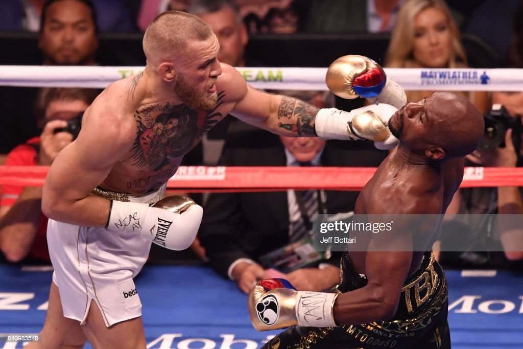 Conor McGregor punches Floyd Mayweather Jr. in their super welterweight boxing match at T-Mobile Arena on August 26, 2017 in Las Vegas, Nevada. Mayweather won by 10th-round TKO.