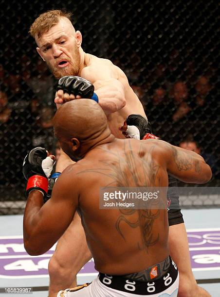 Conor McGregor punches Marcus Brimage in their featherweight fight at the Ericsson Globe Arena on April 6 2013 in Stockholm Sweden