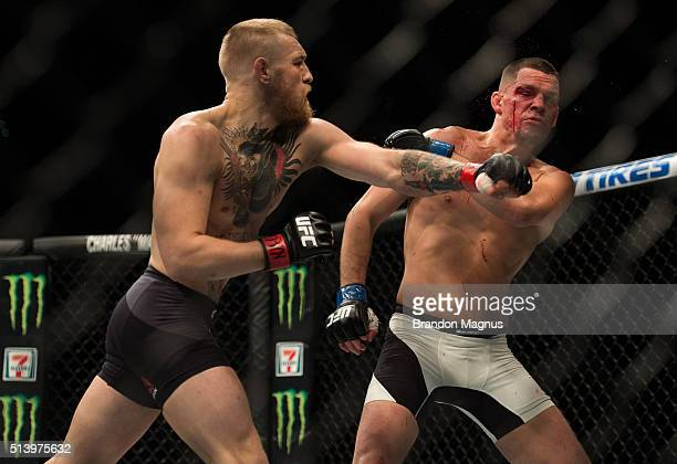 Conor McGregor punches Nate Diaz in their welterweight bout during the UFC 196 in the MGM Grand Garden Arena on March 5 2016 in Las Vegas Nevada
