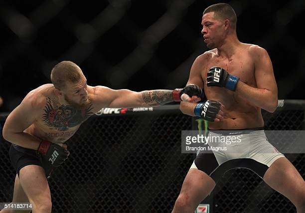 Conor McGregor punches Nate Diaz in their welterweight bout during the UFC 196 in the MGM Grand Garden Arena on March 5, 2016 in Las Vegas, Nevada.