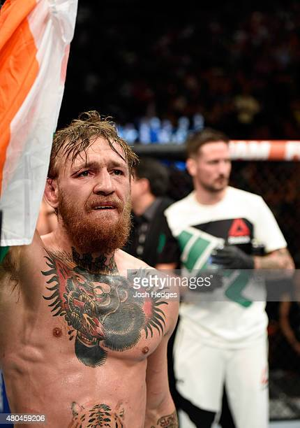 Conor McGregor reacts to his victory over Chad Mendes in their UFC interim featherweight title fight during the UFC 189 event inside MGM Grand Garden...
