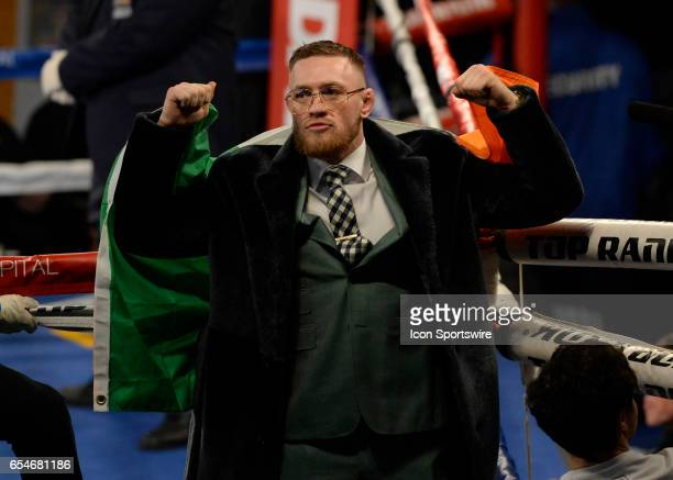 Conor McGregor salutes the crowd prior to the Super Bantamweight bout on March 17 2017 at the The Theater at Madison Square Garden in New York City...