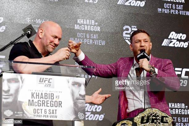 Conor McGregor shares his Irish Whiskey with UFC President Dana White during the UFC 229 Press Conference at Radio City Music Hall on September 20...