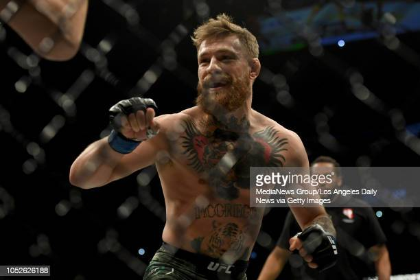 Conor McGregor smiles at Khabib Nurmagomedov during the first round of their match at UFC 229 at the TMobile Arena in Las Vegas Nev Friday Oct 6 2018