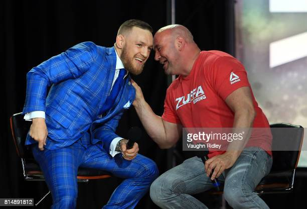 Conor McGregor speaks with UFC President Dana White during the Floyd Mayweather Jr v Conor McGregor World Press Tour at Budweiser Stage on July 12...