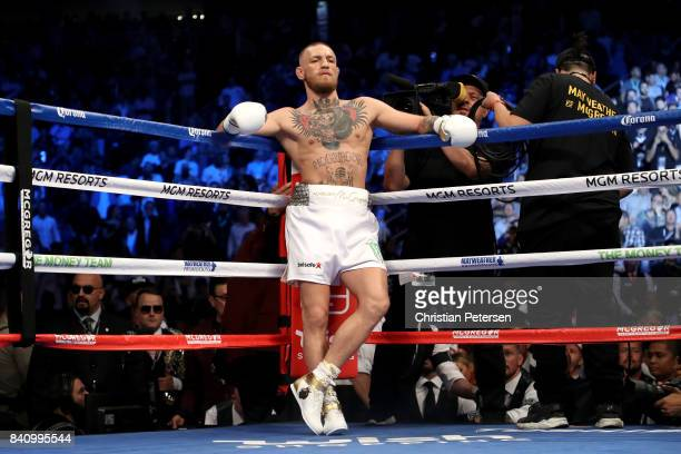 Conor McGregor stands in his corner during his super welterweight boxing match against Floyd Mayweather Jr on August 26 2017 at TMobile Arena in Las...