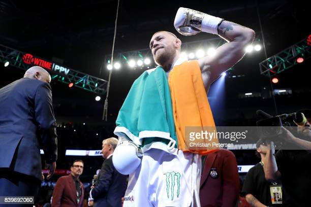 Conor McGregor stands in the ring prior to his super welterweight boxing match against Floyd Mayweather Jr on August 26 2017 at TMobile Arena in Las...