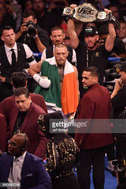 Conor McGregor stares down Floyd Mayweather Jr in their super welterweight boxing match at TMobile Arena on August 26 2017 in Las Vegas Nevada...