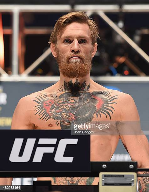 Conor McGregor steps onto the scale during the UFC 189 weighin inside MGM Grand Garden Arena on July 10 2015 in Las Vegas Nevada