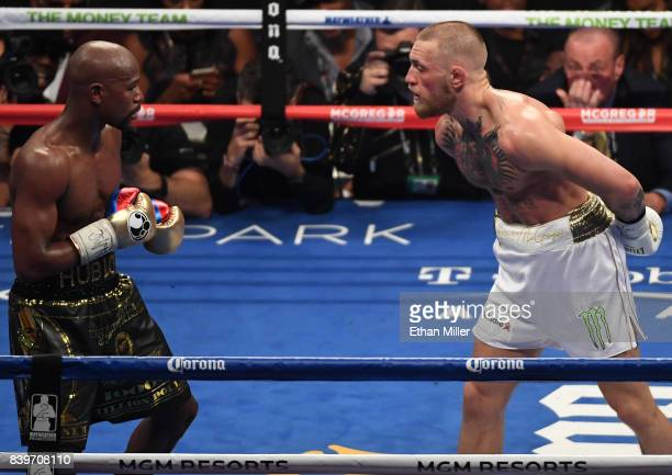 Conor McGregor taunts Floyd Mayweather Jr during their super welterweight boxing match on August 26 2017 at TMobile Arena in Las Vegas Nevada