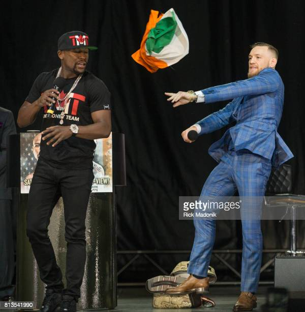 Conor McGregor throws the Irish flag at Floyd Mayweather after Mayweather tried to give it to him Floyd Mayweather and Conor McGregor in town on a...
