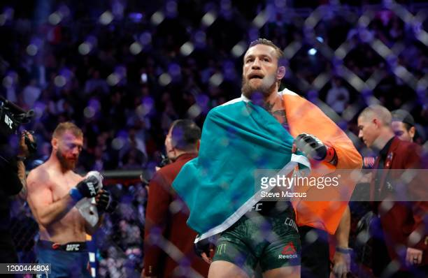 Conor McGregor walks across the Octagon after defeating Donald Cerrone in a welterweight bout during UFC246 at TMobile Arena on January 18 2020 in...