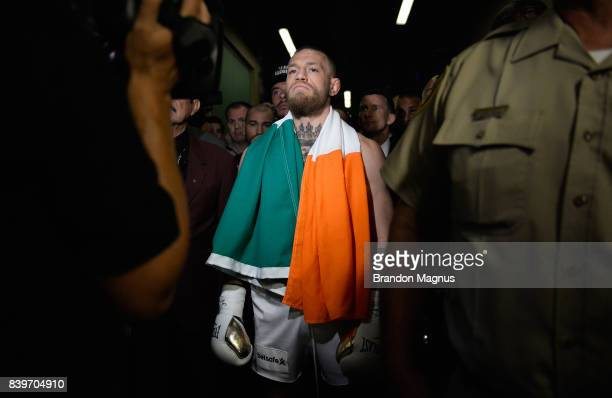Conor McGregor walks to the ring prior to his super welterweight boxing match against Floyd Mayweather Jr on August 26 2017 at TMobile Arena in Las...