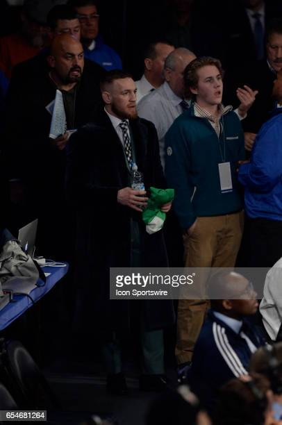Conor McGregor watches the Super Bantamweight bout between Michael Conlan as he battles Tim Ibarra on March 17 2017 at the The Theater at Madison...